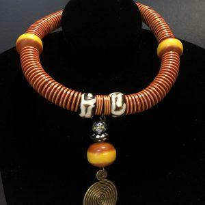 Amber w hanging spiral neck